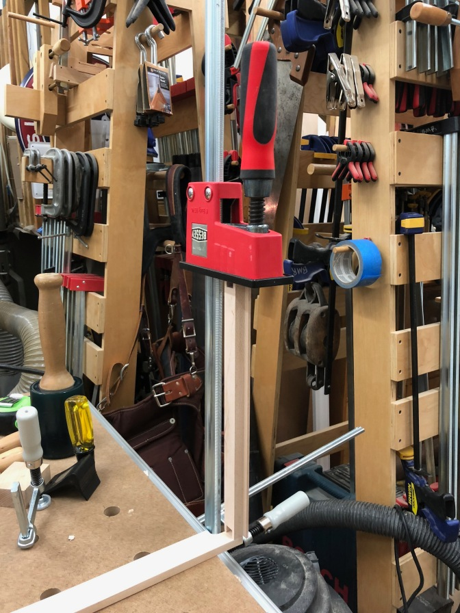 Transferring Pins to a Tail Board by clamping a K-body clamp to the side of your bench
